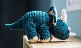 Dinosauro tricottato Immagini Stock