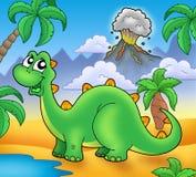 Dinosauro verde sveglio con il vulcano Fotografia Stock