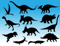 Dinosaurs. Illustration of various dinosaur silhouettes Royalty Free Stock Photography