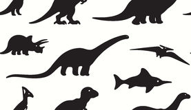 Dinosaurs black silhouettes on white background. Seamless pattern Stock Images
