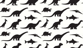 Dinosaurs black silhouettes on white background. Seamless pattern Royalty Free Stock Photography