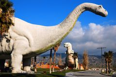 Dinosaurs of Cabazon. Gigantic dinosaurs roam the desert near Cabazon, California. The reptiles were built to draw travelers to a diner near by stock photos