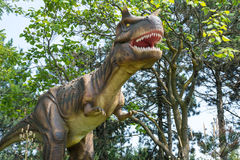 Dinosaurs of different kinds. TORONTO - AUGUST 17: The Exhibition of Dinosaurs at Canadas Wonderland. The are real size simulations of those of the past. The Royalty Free Stock Photography
