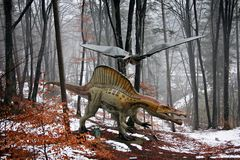 Dinosaurs in the forest. Dinosaurs Pteranodon and Spinosaurus at Rasnov Dino Parc, Brasov County, Romania Royalty Free Stock Image