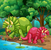 Dinosaurs in the forest Stock Photo