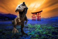 Dinosaurs model in Japan. Dinosaurs model with the background of Tori Gate in Hiroshima, Japan royalty free stock photos