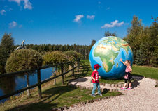 Dinosaurs Park in Leba Poland. Touristic attraction in northern Poland, Dinosaurs Park in Leba.  Children playing at big globe in theme park Stock Image