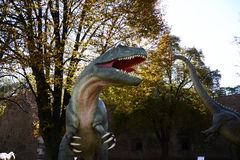 Dinosaurs in park in outdoors Stock Photo
