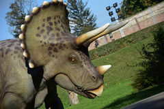 Dinosaurs in park in outdoors Stock Images