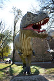 Dinosaurs in park in outdoors Royalty Free Stock Photo
