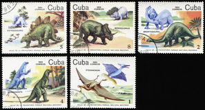 Dinosaurs of prehistoric period. Cuba- CIRCA 1985:  Set of stamps printed in Cuba, shows dinosaurs of prehistoric era: stegosaurus, monoclonius, brontosaurus Royalty Free Stock Photography
