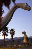 Dinosaurs Roaming. Larger than life dinosaurs roam in a roadside attraction in Cabazon stock photo