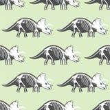 Dinosaurs skeletons silhouettes seamless pattern fossil bone Stock Photo