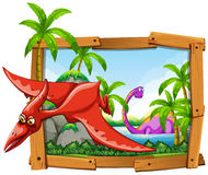 Dinosaurs in wooden frame Royalty Free Stock Photo