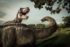 Dinosaurus, Tyrannosaurus met Apatosaurus in het bos stock foto