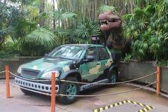 Dinossaur with a car like Jurassic Park movie stock photography