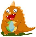 Dinossauro com esfera Fotografia de Stock Royalty Free