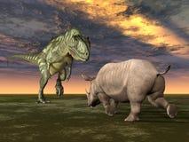 Dinossauro Yangchuanosaurus com rinoceronte Fotos de Stock
