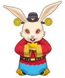 Dio del coniglio di fortuna che tiene una pepita di oro Fotografia Stock