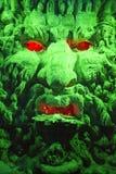 Dio della caverna di verde Fotografia Stock