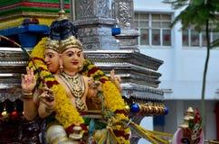Dio indù sul veicolo per la processione Fotografia Stock
