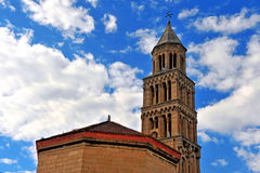Diocletean`s palace bell tower with the blue sky on background Stock Photos