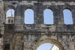 Diocletian Palace detail. Split, Croatia - August 11 2017: Diocletian Palace detail  with Sain Domnous bell tower in the background in Split Stock Image