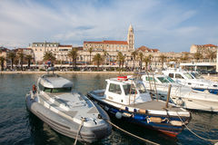 The Diocletian Palace from the harbor with ships in the front in Stock Photos