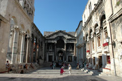 Diocletian palace in Split. SPLIT, CROATIA - AUGUST 7 : People walk and sit inside the Diocletian palace on AUGUST 7, 2007 in Split, Croatia. Diocletian palace Stock Images