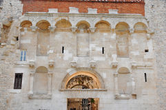 Diocletian's Palace. The golden gate entrance to the UNESCO listed Diocletian's Palace in Split, Croatia. The alcoves are where statues of the emperor and his Royalty Free Stock Photos