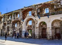 The Diocletian`s Palace in Split, Croatia. Split, Croatia - July 10, 2018: Tourists near Diocletian`s Palace stock images