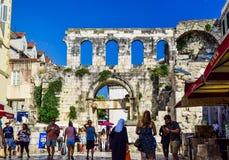 The Diocletian`s Palace in Split, Croatia. Split, Croatia - July 10, 2018: Tourists near Diocletian`s Palace royalty free stock photo