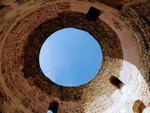Diocletian`s palace in Split, Croatia, looking up through the veticule tower royalty free stock photography