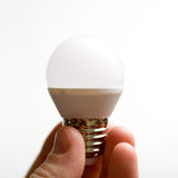 Diode bulb closeup simple composition. Diode bulb close up simple composition in hand stock photos