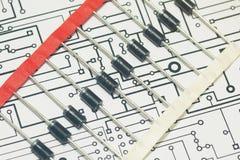 Dioden über elektronischem Diagramm Stockfotos