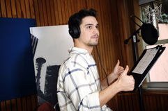 Voice Actor in Studio_Radio Booth_Dubbing_Sound. Portuguese actor Diogo Morgado, in studio, giving voice to Delsin Rowe for the new version of inFAMOUS: Second Stock Photos