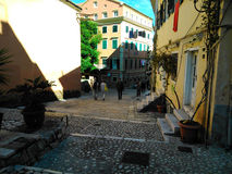 Dionisiou Solomou street. Noon in the old town of Corfu Royalty Free Stock Photo