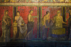 Dionysiac frieze, Villa of Mysteries, Pompeii. Dionysiac frieze, Villa of the Mysteries, before 79 C.E., The fresco is thought to represent a ritual of the Royalty Free Stock Photo