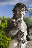 Dionysus, Greek God of wine. View of a stone statue representing the Greek God of wine, Dionysus Royalty Free Stock Photography