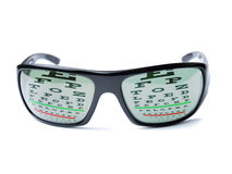 Dioptric sunglasses. Modern dioptric sunglasses with Snellen eye chart as reflection on it Royalty Free Stock Photography