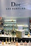 Dior boutique in Central World mall, Bangkok. BANGKOK - DECEMBER 13, 2017: Perfumes at Dior boutique in Central World mall. Central World is the tenth largest Stock Photos
