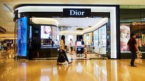 Dior fashion store shop front. Dior cosmetics store front. Modern fashion retail shop with logo of Dior Stock Photos