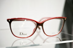 Dior glasses. Dior eyeglasses in a store - focus is on the D in Dior Stock Photos