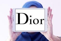 Dior logo. Logo of fashion company dior on samsung tablet holded by arab muslim woman stock photo