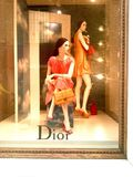 Dior storefront. Window shopping in front of the Dior store in Pesaro royalty free stock images