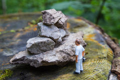 Diorama of man and rocks Royalty Free Stock Images