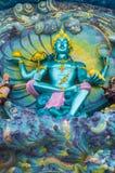 Dios de la escultura de la mitología en la entrada Fotos de archivo