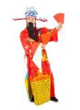 Dios de la riqueza que sostiene el sobre rojo Fotografía de archivo libre de regalías