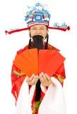 Dios de la riqueza que sostiene el sobre rojo Aislado en blanco Imagenes de archivo