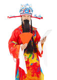 Dios de la riqueza que sostiene el sobre y la tableta rojos Foto de archivo libre de regalías